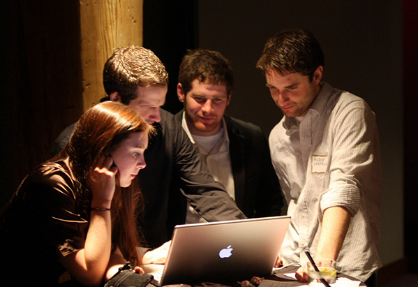Collaboration - group of people around computer