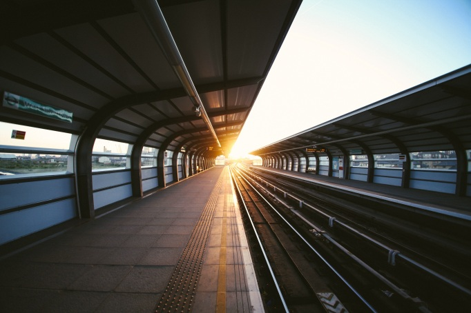 rising sun over train station